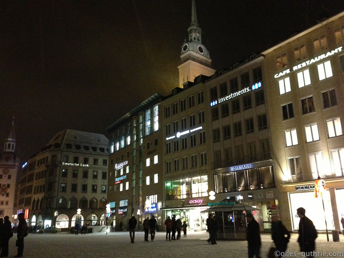 Viktualienmarkt, Marienplatz, at night in heavy snow.